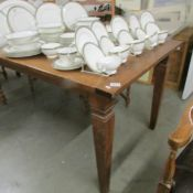"""A good quality oak dining table. The table measures 7'6"""" x 3' Marble size 50"""" x 10""""."""