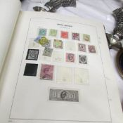 3 stock books / albums of British stamps mostly Elizabeth II but also including other monarchs.