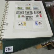 An album of Isle of Man stamps and an album of Gibraltar stamps.