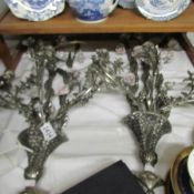 A pair of ornate metal and ceramic wall lights. In good order but would need re-wiring.