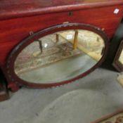 A mahogany framed bevel edged mirror.