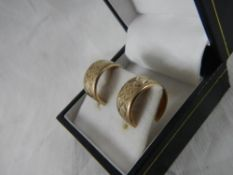 A pair of 1978 diamond cut ear loops in 9ct gold.