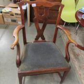 An oak elbow chair.