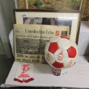 A signed Lincoln City FC football, 2 LCFC paperweights, a pennant,