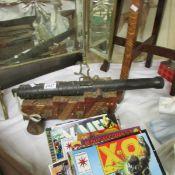 A heavy brass/metal model cannon.