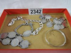A mixed lot of silver including coin bracelets, chain, childs bracelet etc., approximately 62 grams.