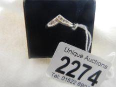 A 7 stone wishbone channel cut yellow gold diamond ring