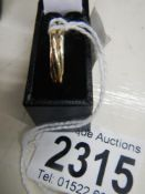 A white, yellow and rose gold 3 band ring dated London 1990.