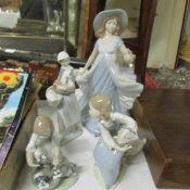 3 Lladro figirines and a Nadal figurine.