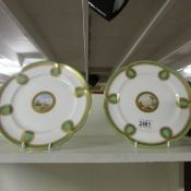 A pair of Minton cabinet plates with hand painted scenes in centres.