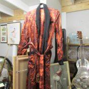 A vintage oriental silk robe.