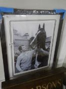 A framed and glazed horse racing print featuring Bob Champion.