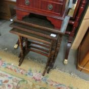 A 20th century mahogany nest of 3 tables with figured leather tops.