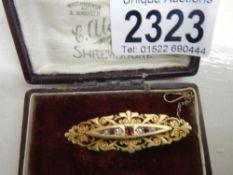 An antique diamond ruby brooch,