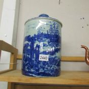 A large blue and white lidded jar.