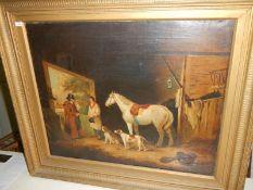 A gilt framed oil on canvas stable scene.