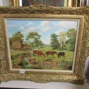 A framed oil on board of horses and foals grazing by Brian Tovey (b.1943) 68 x 58 cm.