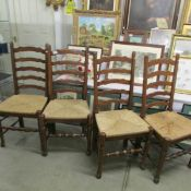 A good set of 4 oak ladder back chairs with rush seats.