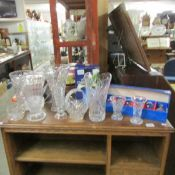 A mixed lot of cut glass vases etc.