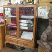 A walnut display cabinet.