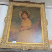 A framed print of a young girl. Frame 59 x 69 cm. Inner measurement 44 x 56 cm.