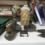 4 tribal carvings.