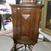 A mahogany corner cupboard on stand.