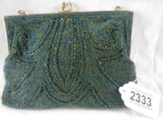 A fine quality beadwork evening bag together with a circa 1940's compact with stone set top.