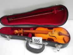 """A small cased violin with bow, 9"""" long."""