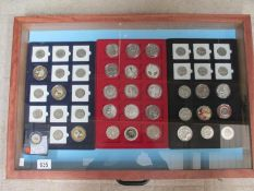 A jewellery display case containing various commemorative coins including crowns, 50p,