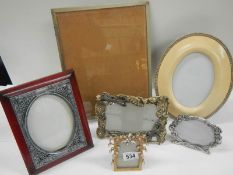 6 Interesting photograph frames including a 1920's example on ball feet.