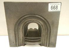 A cast iron traveller's sample fire place.