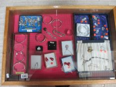 A display case of silver bangles, charms, earrings etc., (this lot is buyer collect only).
