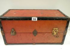 """An small travel trunk containing drawers, 20.5"""" (50cm) x 10"""" (25cm) x 10"""" (25cm)."""