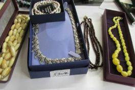 4 necklaces including 3 strand garnet and 3 cultured pearl bracelets.