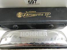A Hohner Chrometta 12 harmonica.