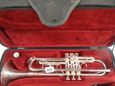 A Besson 1000 silver plate trumpet complete with mouthpiece and in good condition.