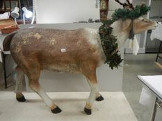 """A full size model of a reindeer, 36"""" tall x 60"""" long (crack to back leg)."""