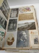 A large and voluminous Victorian and Edwardian Album containing postcards,cigarette cards,