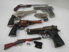 A quantity of replica hand guns.