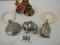 4 vintage baby teething bells.