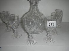 A good quality cut glass decanter and 6 glasses, in good condition.