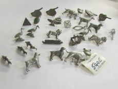 A mixed lot of pin badges including animals.