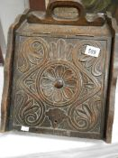 A 1920's ornately carved coal box with liner.