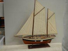 """A model sailing boat, 30"""" long x 32"""" high."""
