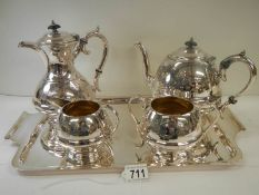 A good quality silver plate 4 piece tea set on a silver plate tray.