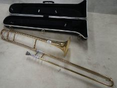 A cased trombone by Blessing Scholastic, Made in U.S.A.