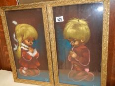 A pair of paintings of children.