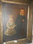 An antique painting of children. ****Condition report**** Picture size; 39.5cm x 54.