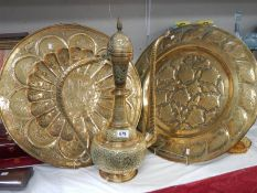 """2 large brass plates and a 22"""" tall brass jug."""